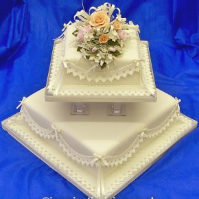 Charmaine - Square Ivory Wedding Cake with delicate coloured sugar flowers, lace effect frills & satin bows