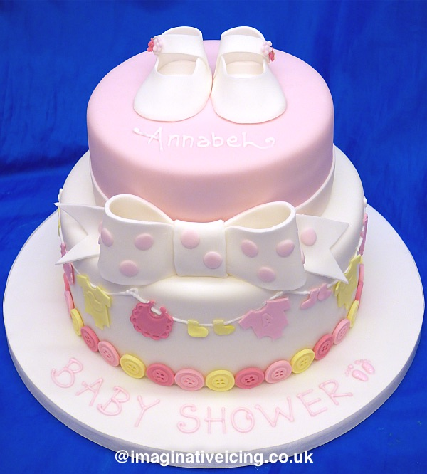 baby shower cake with washing line, buttons, bow and booties - Also suitable as a Christening Cake with altered inscription