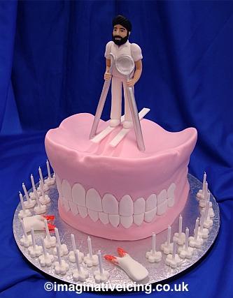 Dentist Skiing on top of a set of False Teeth Birthday Cake
