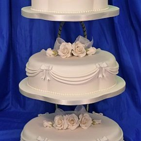 Scolloped Oval Ivory Wedding Cake