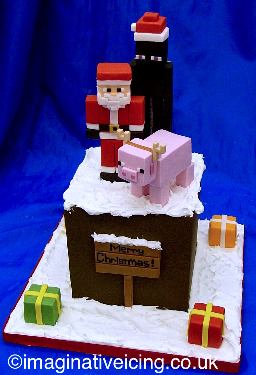 Minecraft Christmas Cake as a cube block with icing snow and icing models of Enderman, Father Christmas, Pig, Christmas presents