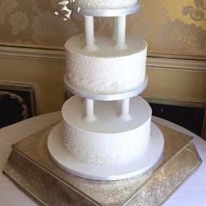 Classic Retro Royal Iced Tiered Wedding Cake with icing flowers