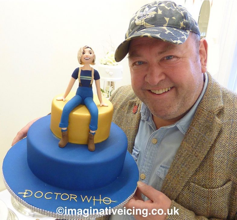 "Actor Mark Addy meets the Sweet toothed 13th Doctor Jodie Whittaker who has been created in cake icing form at Imaginative Icing - Cakes.  In 2018 Mark Played the character of Spaceship Captain Greston Paltraki in the Doctor Who series 11 episode ""The Battle of Ranskoor Av Kolos""  The 12th series of new Doctor Who starring Jodie as the 13th Doctor starts on New Years Day 2020."