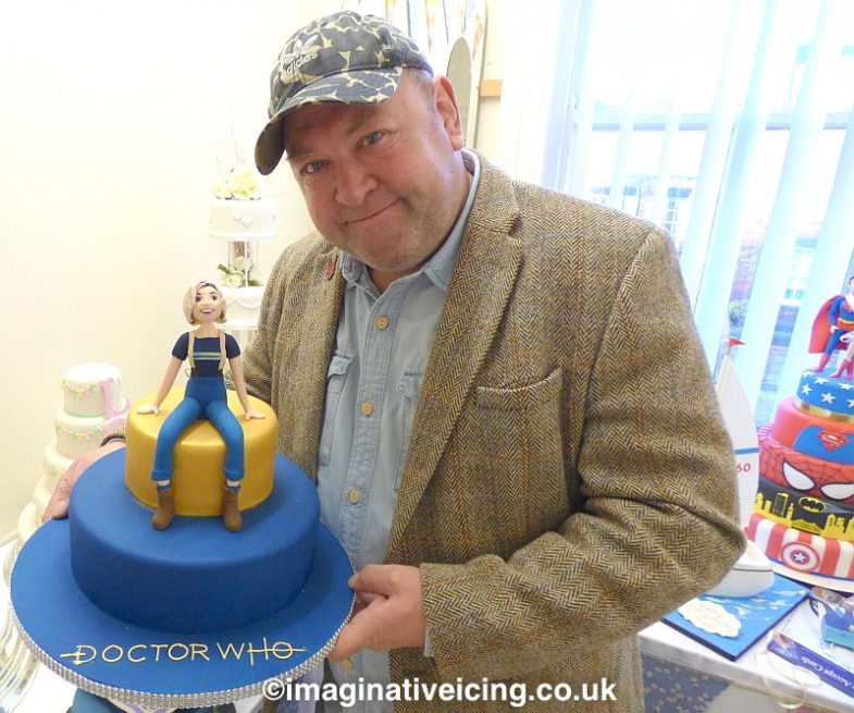 "Actor Mark Addy meets the Sweet toothed 13th Doctor Jodie Whittacker who has been created in cake icing form at Imaginative Icing - Cakes.  In 2018 Mark Played the character of Spaceship Captain Greston Paltraki in the Doctor Who series 11 episode ""The Battle of Ranskoor Av Kolos""  The 12th series of new Doctor Who starring Jodie as the 13th Doctor starts on New Years Day 2020."