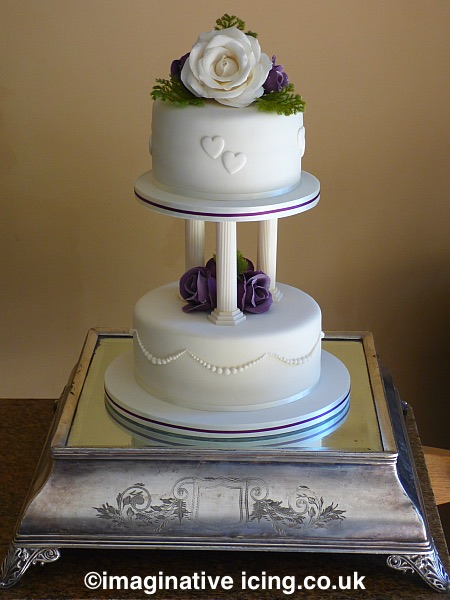 2 tier Mini Wedding Cake on pillars with Sugar Flowers - Handcrafted Sugar Roses. Ivory and Purple/plum. colours can be changed to suit.
