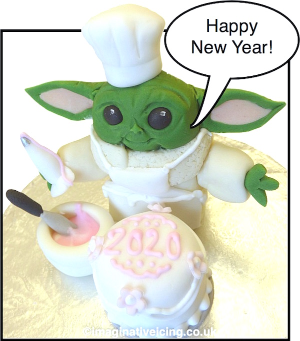 Happy New Year! here's an edible icing model of 'Baby Yoda' icing a cake to welcome in the 2020's Enjoy!  For those of you that haven't seen The Mandolorian space western which premiered on Disney+ in 2019 yet 'baby Yoda' or 'The Child' is not yoda but a baby of the same species of alien as Yoda that the main character in the web tv series finds and then takes resposibility for.... equal measures of cuteness / chaos and distruction ensues.. like Yoda 'The Child' has the force with-in him...