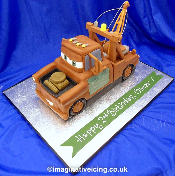 3D Tow Truck shaped birthday cake - Mater from the movie Cars This cake was shaped to look like the birthday boys' favourite toy vehicle.