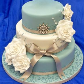 3 tier pearlised Blue & Ivory vintage wedding cake with sugar flowers