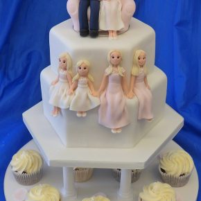 """Wedded to the Family"" Wedding Cake with Icing Bride & Groom topper and Icing Models of children."