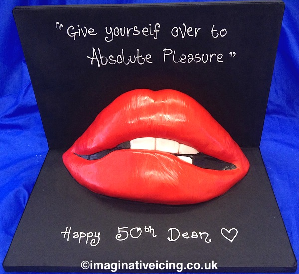 """Give yourself over to absolute pleasure!"" - Rocky Horror Picture Show Red Lips Cake. Cake boards iced in black to set off the red lips that are sculpted from cake. Inscription of choice piped in white icing."